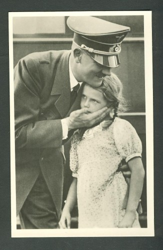 Hitler hugs a young girl.jpg